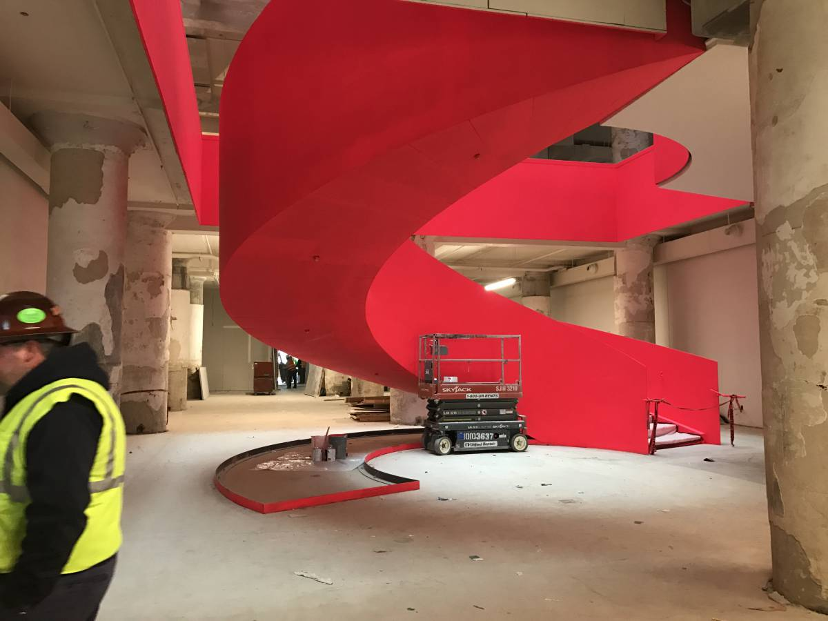 fluorescent coral staircase at Crosstown Concourse